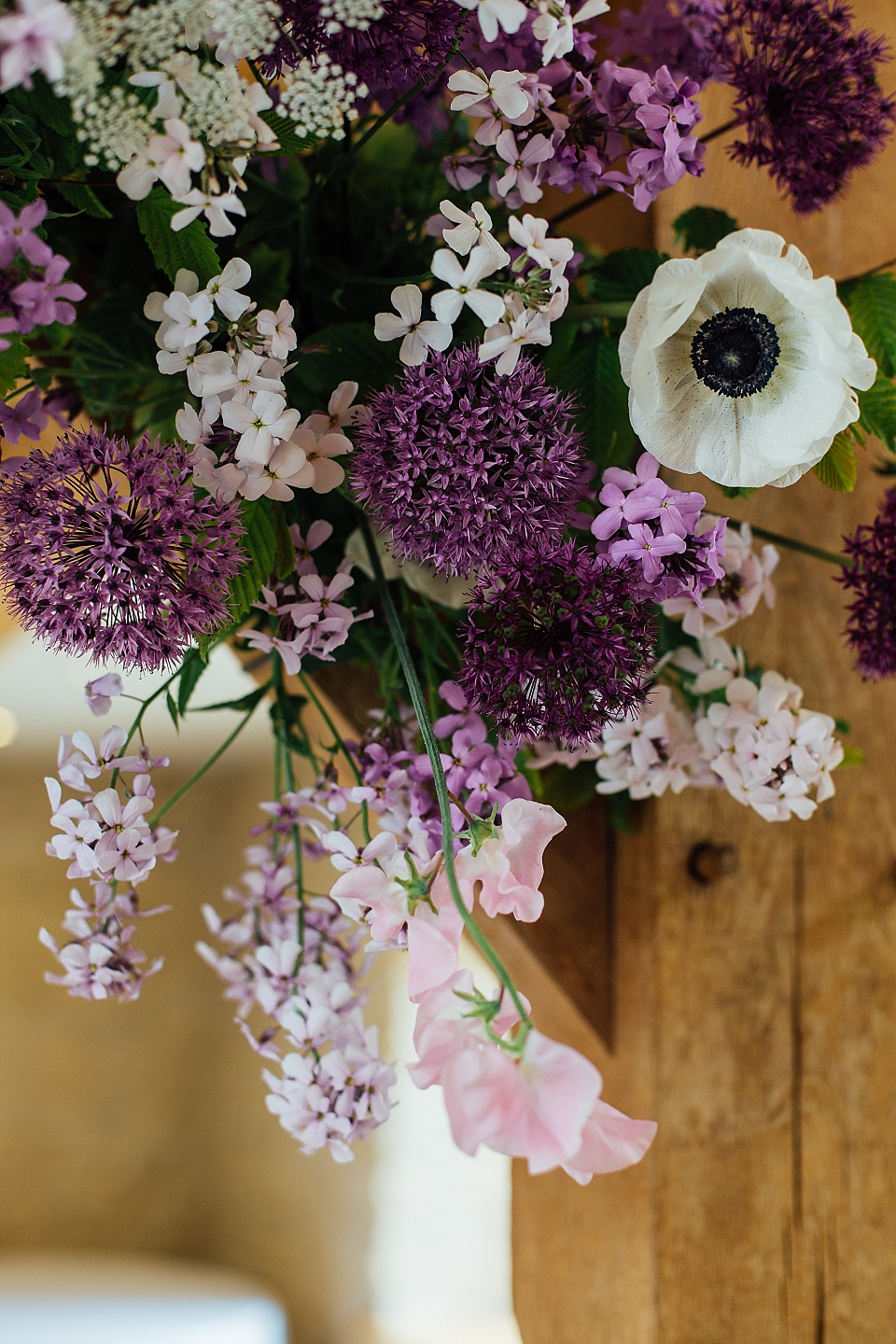 Purple and white floral arch